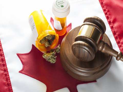 Marijuana and gavel on Canadian flag.