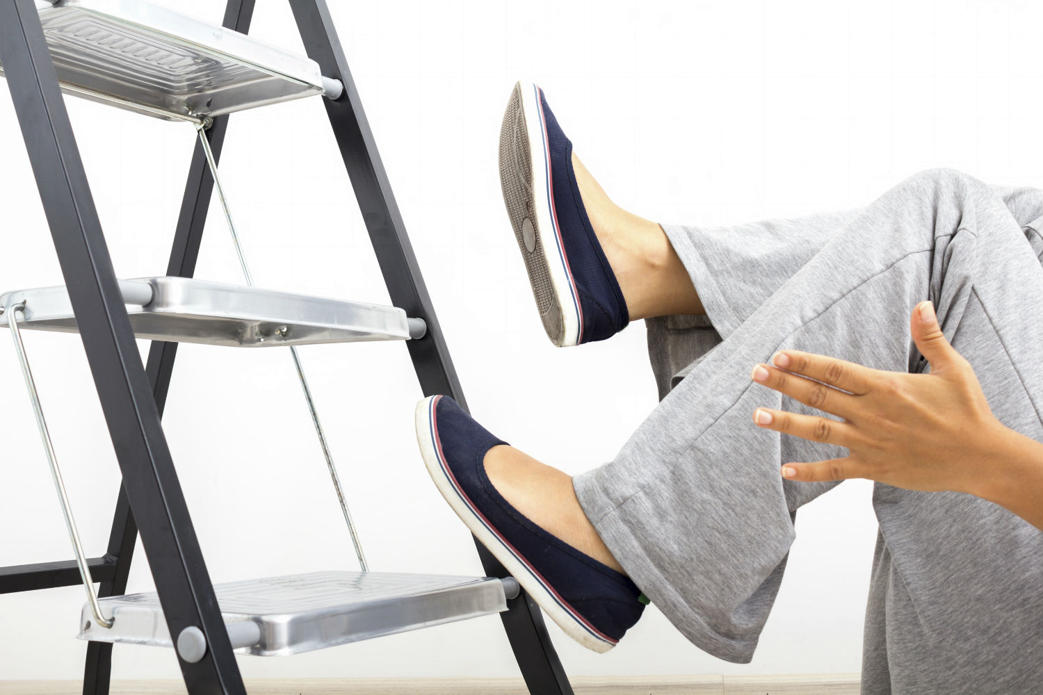 Woman falling from a step ladder